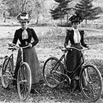 Two Victorian era women on bicycles