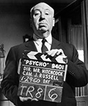 Alfred Hitchcock with Psycho Clapboard