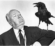 Alfred Hitchcock with Bird on his arm