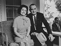 Lyndon B Johnson with his wife on his front porch