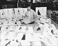 Edith Head surrounded by her sketches